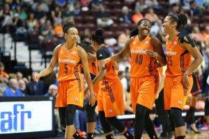 Jasmine Thomas, Shekinna Stricklen and Alyssa Thomas share a laugh on court. Photo by Chris Marion/NBAE via Getty Images.