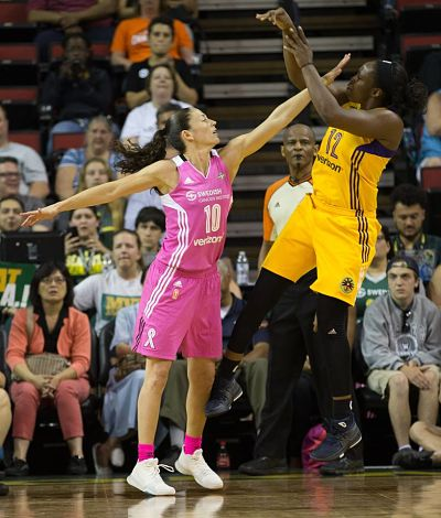 Sue Bird gets a hand in front of Chelsea Gray's face. Photo by Neil Enns/Storm Photos.