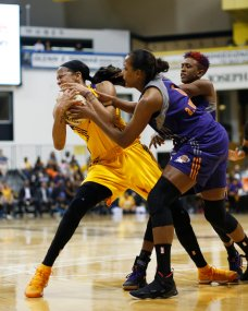Candace Parker is fouled by Danielle Robinson and Angel Robinson. Photo by Maria Noble/WomensHoopsWorld.