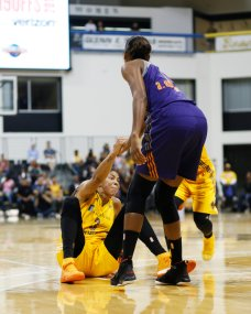 Candace Parker is helped up after the foul. Photo by Maria Noble/WomensHoopsWorld.