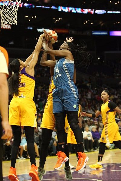 Sylvia Fowles tries to get a shot past Candace Parker. Photo by Benita West/TGSportsTV1.