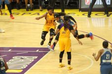 Maya Moore struggles to beat Alana Beard's defense. Photo by Benita West/TGSportsTV1.
