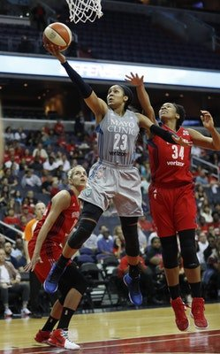 Maya Moore drives past Krystal Thomas to score in the first half. Photo by Pablo Martinez Monsivais/Associated Press.