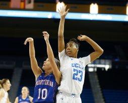 Cortney Storey shoots past Kelli Hayes' defense. Photo by Maria Noble/WomensHoopsWorld.