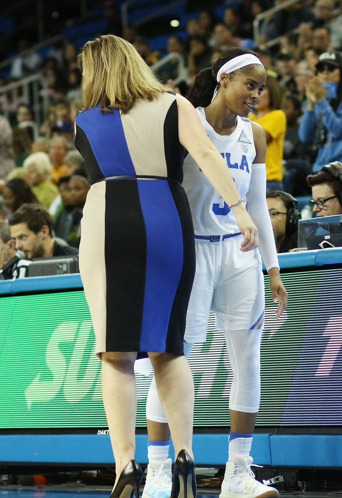 Cori Close and Jordin Canada head for the post-game handshake line. Photo by Maria Noble/WomensHoopsWorld.