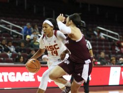 Sadie Edwards is guarded by Chennedy Carter. Photo by Maria Noble/WomensHoopsWorld.