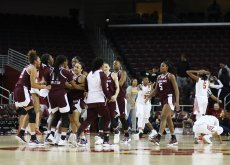 Aggies players hug after the win. Photo by Maria Noble/WomensHoopsWorld.