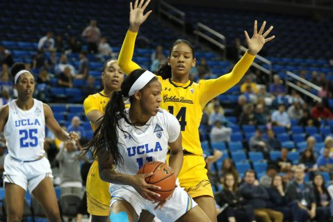 Lajahna Drummer is defended by Kianna Smith. Photo by Maria Noble/WomensHoopsWorld.