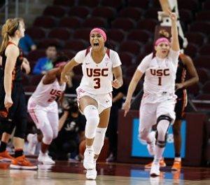 Minyon Moore, left and Jordan Adams celebrate USC's upset of No. 16 Oregon State. Photo by Hali Helfgott/USC Athletics.