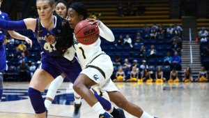 Cal's Asha Thomas drives on Washington's Missy Peterson. Photo courtesy of Pac-12 Network.