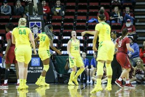 From left: Mallory McGwire, Ruthy Hebard, Sabrina Ionescu and Justine Hall are fired up near the end of the Pac-12 Tournament Championship game. Photo courtesy of Pac-12 Network.