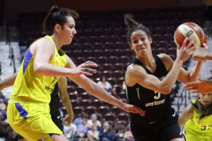 Kia Nurse drives to the basket for two point. Photo courtesy of the UConn Blog.
