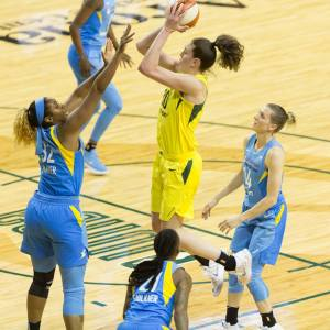 Breanna Stewart elevates over defenders to score. Neil Enns/Storm Photos.