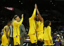 Candace Parker and Nneka Ogwumike share a few words. Maria Noble/WomensHoopsWorld.