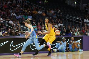Candace Parker passes around her back to escape the defense. Photo by Maria Noble/WomensHoopsWorld.