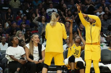 Maria Vadeeva, second from left, talks with teammates about shooting. Photo by Maria Noble/WomensHoopsWorld.