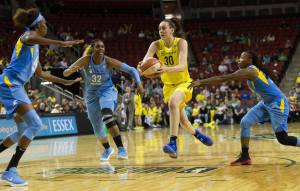 Breanna Stewart drives to the hoop.  Neil Enns/Storm Photos.