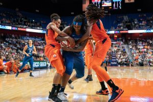 Courtney Williams and Jonquel Jones battle Lynetta Kizer for ball possession. Photo by Chris Poss.