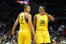 Candace Parker and Nneka Ogwumike confer during a game pause. Maria Noble/WomensHoopsWorld.