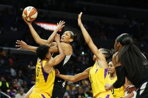 A'ja Wilson tries to execute against Alana Beard. Maria Noble/WomensHoopsWorld.