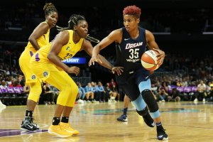 Angel McCoughtry drives around the Sparks defense. Maria Noble/WomensHoopsWorld.