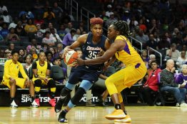Angel McCoughtry is defended by Chelsea Gray. Maria Noble/WomensHoopsWorld.