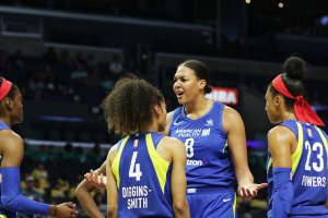 Liz Cambage, center, reacts to being called for one of two technical fouls in a game against Los Angeles last month. Maria Noble/WomensHoopsWorld.