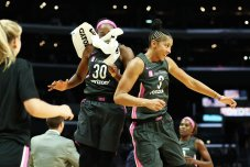 Nneka Ogwumike and Candace Parker jump to celebrate a basket. Maria Noble/WomensHoopsWorld.
