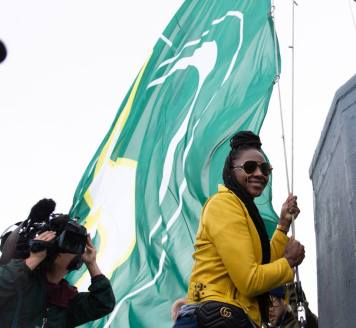 Crystal Langhorne helps hoist the flag. Neil Enns/Storm Photos.