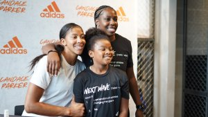 Candace Parker and daughter Lailaa pose with Sparks point guard Chelsea Gray. Photo courtesy of Adidas.