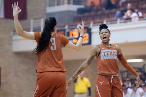 "Danni Williams, left, and Sug Sutton celebrate a three-point shot at the ""Texas Tipoff"" this week. Photo courtesy of Texas Athletics."