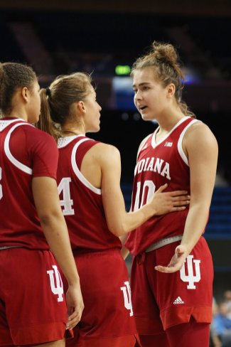 Hoosier players confer during a timeout. Photo by Maria Noble/WomensHoopsWorld.