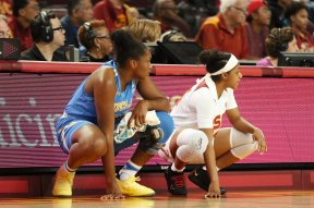 Lauryn Miller and Desiree Caldwell wait to get into the game. Maria Noble/WomensHoopsWorld.