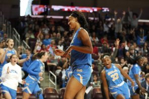 Lajahna Drummer smiles as her teammates yell after her shot. Maria Noble/WomensHoopsWorld.