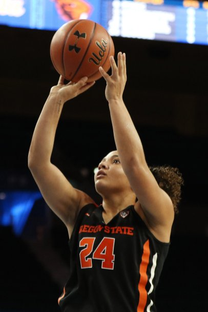 Destiny Slocum scores two of her 15 points on the night. Maria Noble/WomensHoopsWorld.