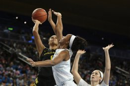 Satou Sabally is defended by Lajahna Drummer. Maria Noble/WomensHoopsWorld.