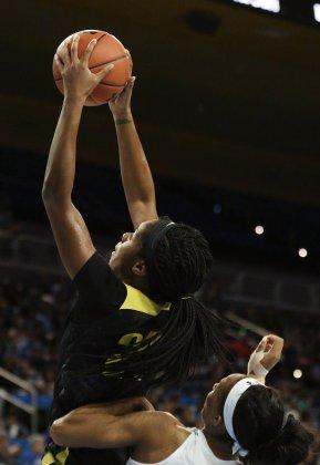 Ruthy Hebard snares the rebound. Maria Noble/WomensHoopsWorld.