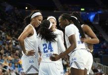 UCLA huddles in the third quarter. Maria Noble/WomensHoopsWorld.