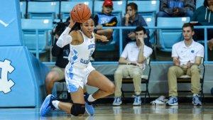 Stephanie Watts passes from one knee. Photo courtesy of North Carolina Athletics.