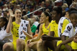 Breanna Stewart sits with Sue Bird, Natasha Howard, Jewell Loyd and the rest of the Storm bench as a game winds down. Photo courtesy of Seattle Storm.