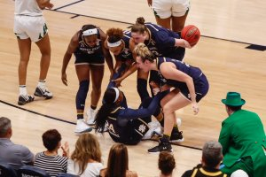 Jackie Young, Brianna Turner, Jessica Snepard and Marina Mabrey help Arike Ogunbowale up after a foul. Photo courtesy of Notre Dame Athletics.