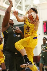 Friday, May 17, 2019 - Sydney Wiese tries to drive over Courtney Paris. Maria Noble/WomensHoopsWorld.
