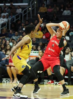 Kayla McBride is defended by defensive player of the year Alana Beard. Maria Noble/WomensHoopsWorld.