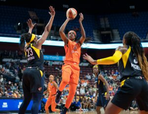 Jonquel Jones shoots over the Indiana Fever defense. Chris Poss photo.