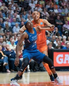 Asia Taylor boxes out during a recent game. Chris Poss photo.