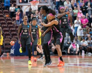 Courtney Williams, Shekinna Stricklen, Jasmine Thomas and Jonquel Jones celebrate Stricklen's game-winning three-point shot against the Storm. Chris Poss photo.