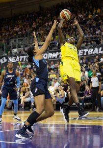Natasha Howard puts up a shot against Monique Billings. Neil Enns/Storm photos.