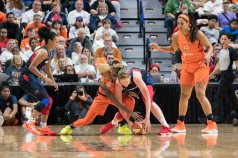Connecticut Sun guard Courtney Williams (10) and Washington Mystics forward Emma Meesseman (33) battle for the ball during Game 3 of the WNBA finals between the Washington Mystics and the Connecticut Sun at Mohegan Sun Arena, Uncasville, CT, USA on October 06, 2019. Photo Credit: Chris Poss
