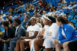 Michaela Onyenwere and Lindsey Corsaro talk on the bench. Maria Noble/WomensHoopsWorld