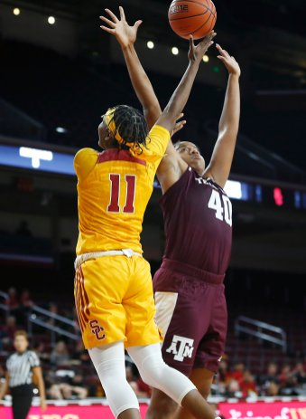 Aliyah Jeune is defended by Ciera Johnson. Maria Noble/WomensHoopsWorld